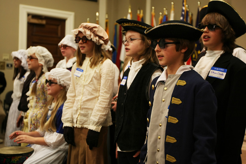 Fisher elementary gifted and talented students perform a rap about the Bill of Rights at the capital building Friday morning.