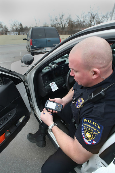 Broken Arrow Officer Brett Burton uses the DigiTicket system to issue a citation.