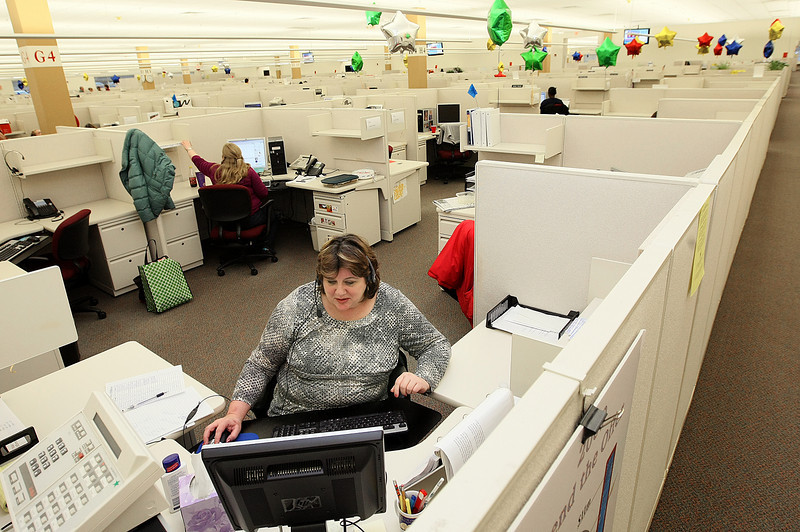 Kristy Summers, customer care representative at the Hartford Financial Services Group Inc.,  takes customer calls Thursday. PHOTO BY MAIKE SABOLICH