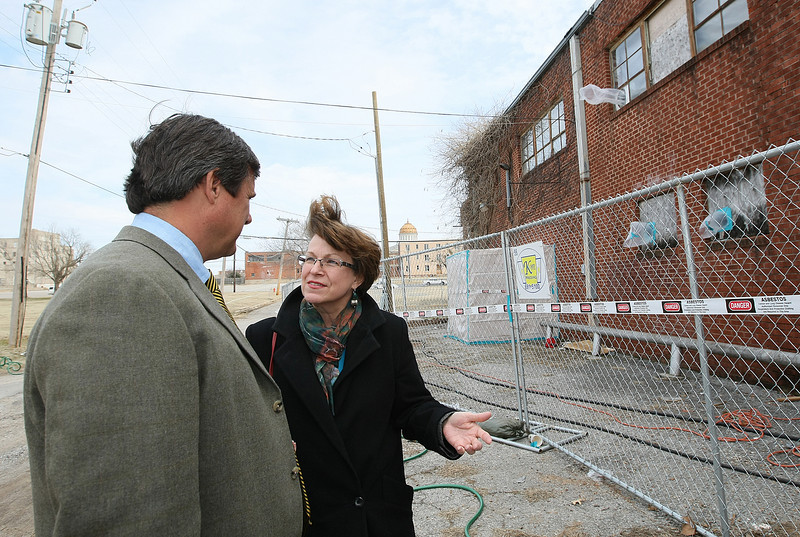 Steve Mason with Cardinal Engineering and Susan Hogan with the city of Oklahoma City are discussing the redevelopment of the  Red Cross Building on NW 10th Street Thursday. PHOTO BY MAIKE SABOLICH