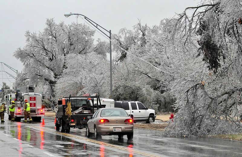 Lawton firemen block off part of a road to keep motorists from driving over downed power lines in Lawton, Okla., Thursday, Jan. 28, 2010.  (AP Photo/ Jeff Dixon, Lawton Constitution)