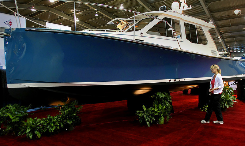 Cindy Marshall readies a True North boat on display at the Tulsa Boat, Sport & Travel Show for the opening Monday night.