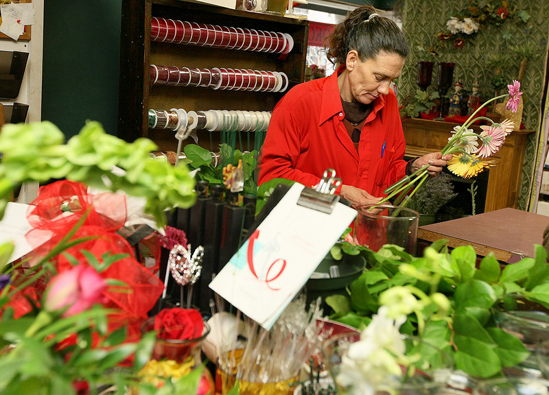 Nancy Maxwell helps out with flower preparation and delivery at OKC Florist during the Valentines season. PHOTO BY MAIKE SABOLICH