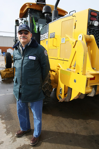 Superintendent of Streets, Traffic, and Drainage Maintenance of Oklahoma City Mike DeGiacomo stands in front of a motor grader Tuesday afternoon. The grader can be used both for road construction and for removal of ice from the roads, DeGiacomo said.