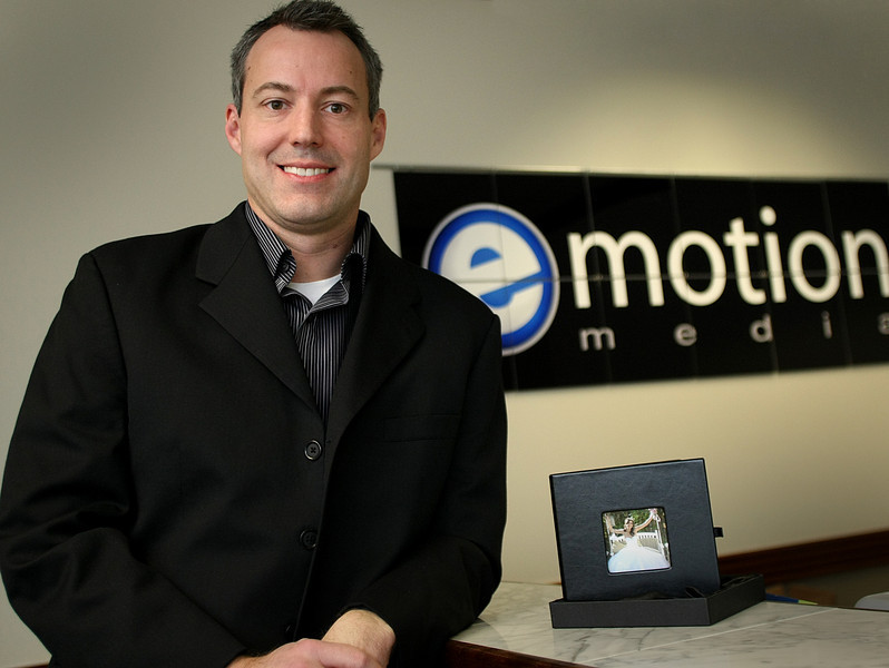 Brain MacMurray, CEO of Emotion Media, pauses for a photos in his South Tulsa office.