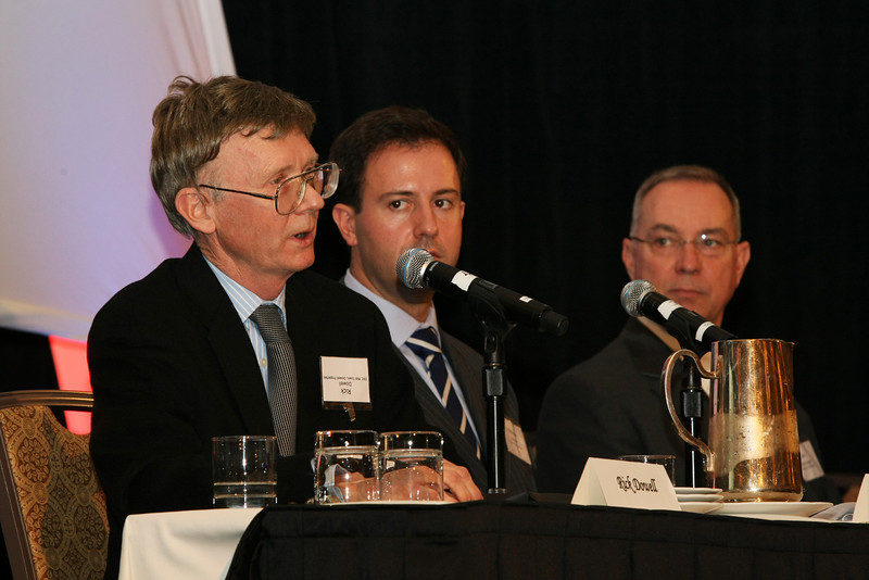 Rick Dowell speaks at the Forecast Conference held by the Commercial Real Estate Council Tuesday afternoon while Matthew Bristow and Jim Huntzinger, both sitting on the same panel, listen.