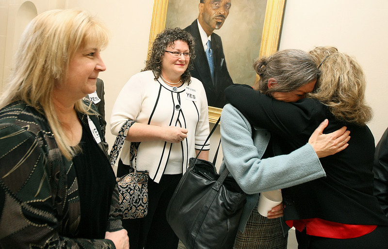 Southeastern Oklahoma residents Karen Julian, Lindy Silk, Dian Jordan and Wenda Blankenship react emotionally to the House Economic Development and Financial Services committee's unanimous vote to exempt cabin rental companies from the state's real estate code and regulate them, instead, under the Oklahoma Innkeeper Act. PHOTO BY MAIKE SABOLICH