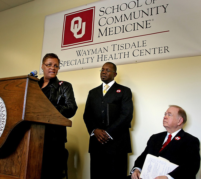 Oklahoma University President David Boren listens as Regina and Weldon Tisdale  speak to the crowd gathered at the ground breaking ceremony of the Wayman Tisdale Specialty Health Center in North Tulsa