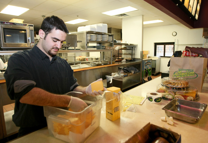 Markie's cashier Judah Brown is in the process of preparing catering trays Thursday. PHOTO BY MAIKE SABOLICH