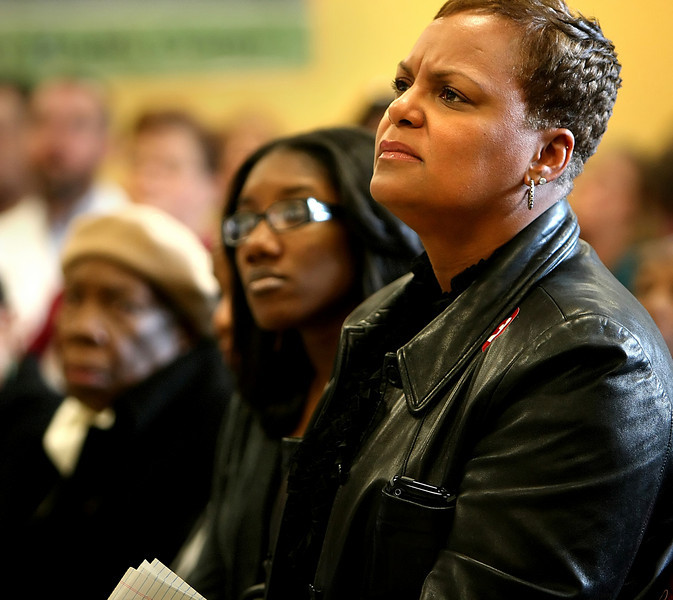 Members of Wayman Tisdales family, Regina, Whitney and Devora Tisdale, listen to a speech during the ground breaking ceremony of the Wayman Tisdale Specialty Health Center in North Tulsa