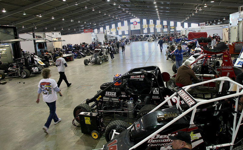 The floor of the QT Center on the Tulsa fairgrounds is covered with racing teams preparing for the annual Chili Bowl race.  The week long racing event brings millions of dollars of revenue into the Tulsa economy each year.