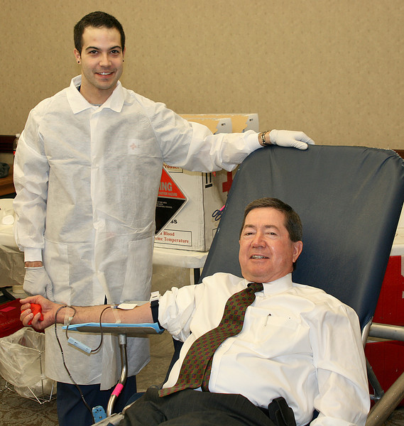 Attorney General Drew Edmondson with Dustin Lawrence, team lead, American Red Cross. <br /> Blood drive at AG's office