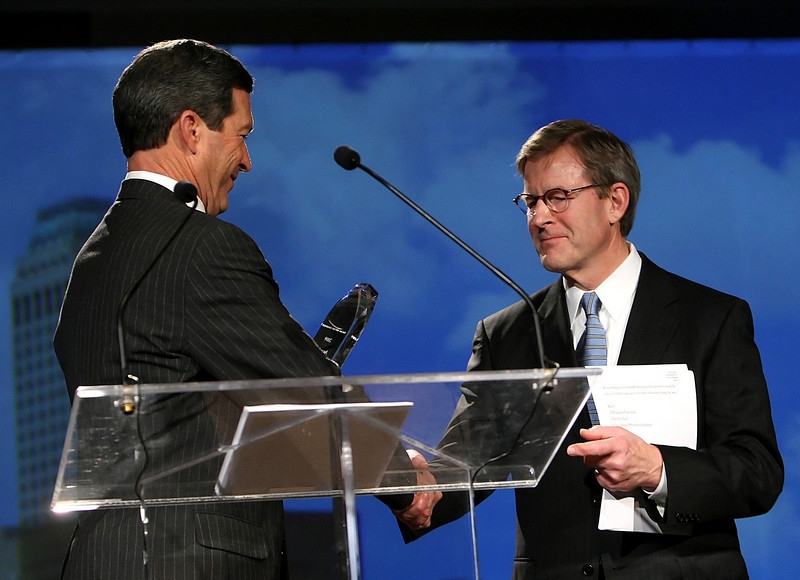 Don Walker takes over the Tulsa Metro Chamber of Commerce Chairman of the Board position from the outgoing Chairman David Page during the the Annual Meeting and Inauguration luncheon held Tuesday.
