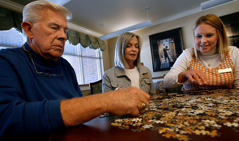 Bill Grahlman, Cindy Bell and  Chandra Crowley work on a puzzle at the Canoe Brook assisted living.