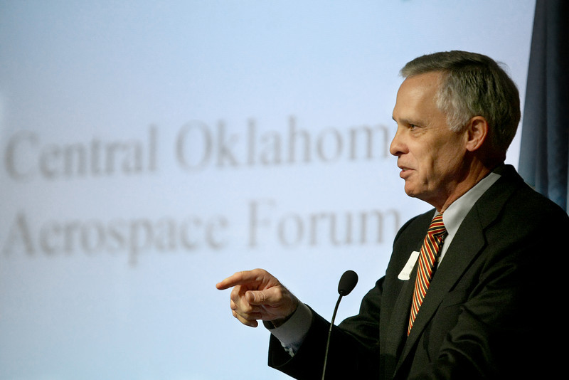 Kirk Humphreys, vice chairman for Aviation and Aerospace of the Greater Oklahoma City Chamber of Commerce, opens the Oklahoma Aerospace Forum at the Oklahoma History Center Tuesday. PHOTO BY MAIKE SABOLICH