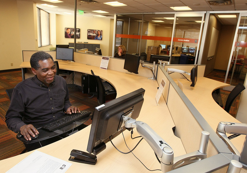 University of Phoenix's doctoral student Clarence H. Seals Jr. works in the university's new research center Tuesday. PHOTO BY MAIKE SABOLICH