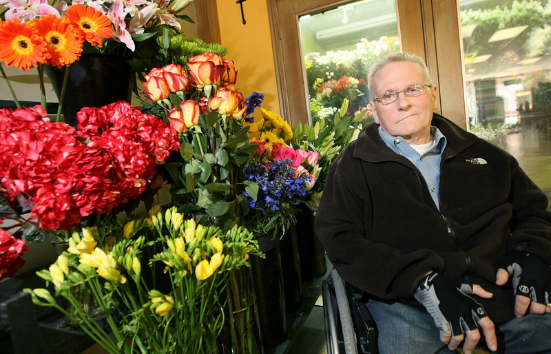 Lester Howard, owner of Howard Brothers Florists. Monday Howard Brothers was completing its move into the first building the company has owned in its 63 years of business. The new building is located at 8700 S. Pennsylvania Ave.  PHOTO BY MAIKE SABOLICH