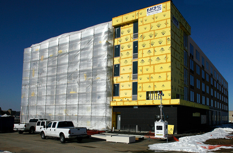 A new hotel wrapped in plastic sheeting to protect the building from the cold is being built along Hwy 169 in South Tulsa.