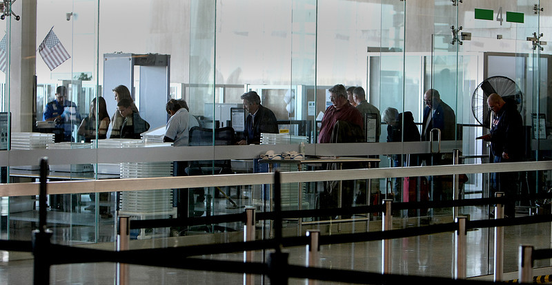 Passengers line up to go through the TSA security check at the Tulsa International Airport Friday.