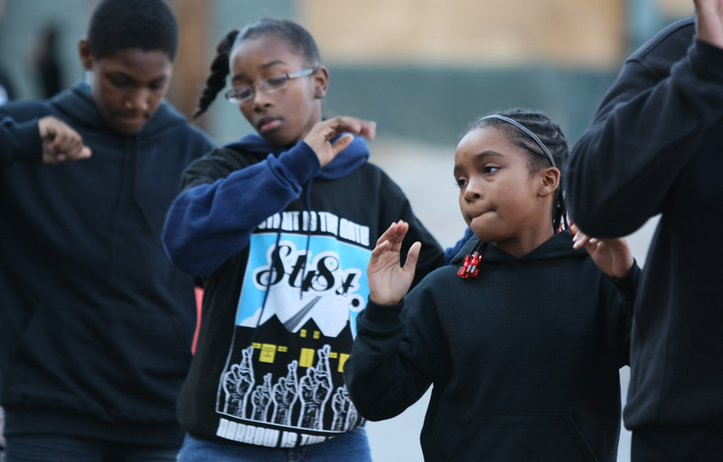 Rikki Abdallah, right, Jordan Harrison and other members of Emmanuel Tabernacle participate in Monday's Martin Luther King Parade through Bricktown. PHOTO BY MAIKE SABOLICH