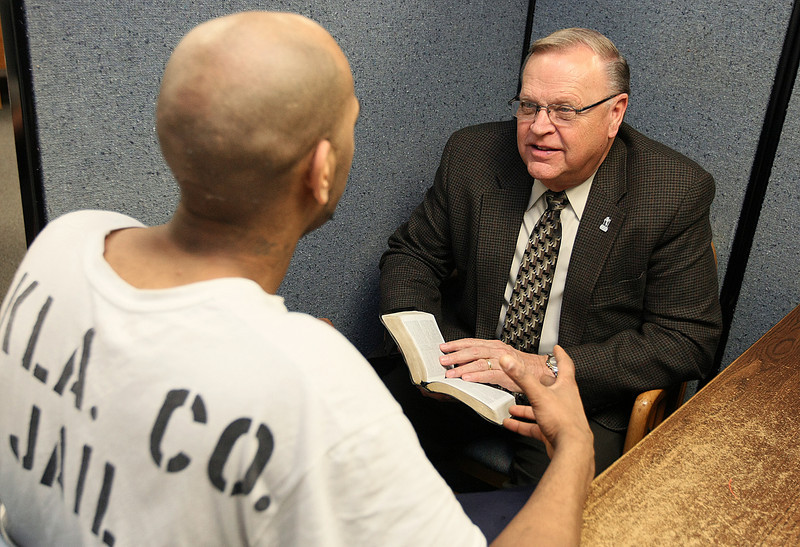 Prison Chaplain Argyl Dick with inmate Ted during a Bible study at the Oklahoma County Jail. PHOTO BY MAIKE SABOLICH