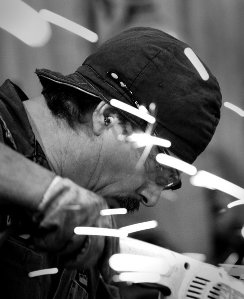 A Workmans head is surrounded by sparks as he works to repair equipment at Darby Equipment Company in Tulsa.