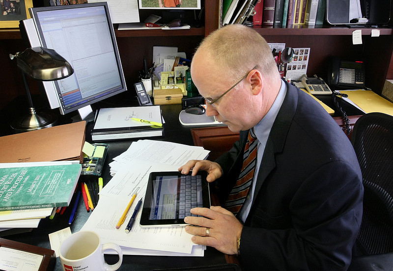 Will Hoch, III, attorney with Crowe & Dunlevy, works on his iPad Wednesday. PHOTO BY MAIKE SABOLICH