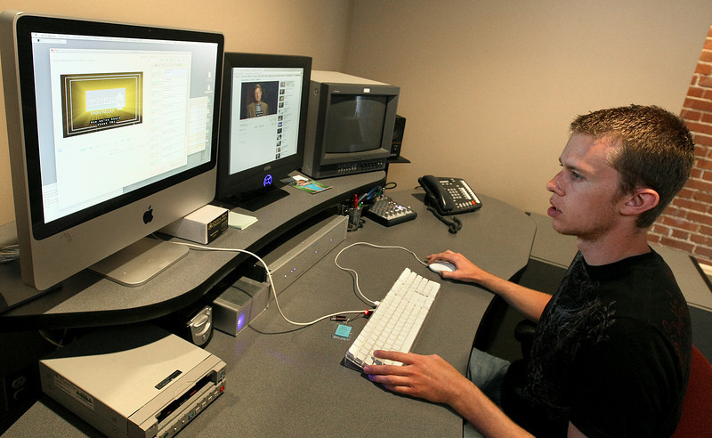 Micah Ownbey, editor with Mass Media Productions, adds caption information to a video. PHOTO BY MAIKE SABOLICH
