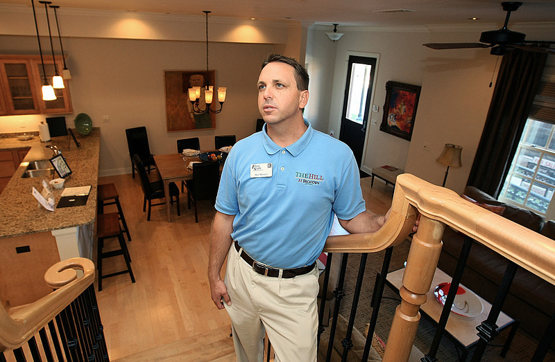 Matt Marcacci, real estate agent, talks about a model home at The Hill, urban housing in downtown Oklahoma City. PHOTO BY MAIKE SABOLICH