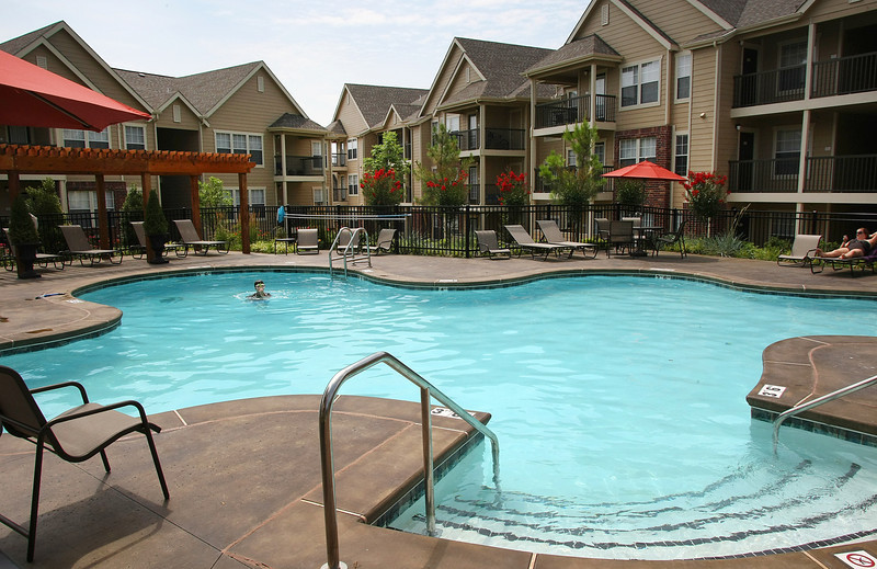 A child gets some swimming in at a local Tulsa apartment complex.