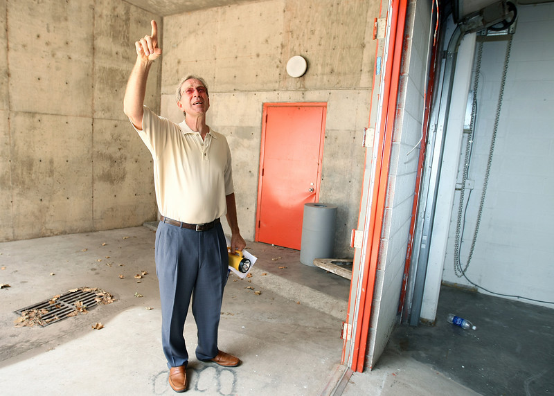 Peter Dolese, executive director at Arts Council of Oklahoma City, shows where the flood water entered through secured steel doors into the Stage Center. In response to the 1993 flood steel doors with four hinges on each side were installed that opened to the ouside of the basement. The water masses during the current flood pushed the doors in despite of all pre-planned security measures.  PHOTO BY MAIKE SABOLICH