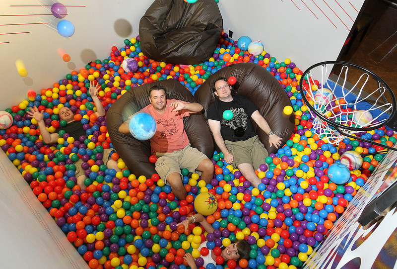 Insight Creative Group's Tim Krause, Rusty Duncan, Chelsi Lecrone and Doug Farthing in the comapny's ball pit. PHOTO BY MAIKE SABOLICH