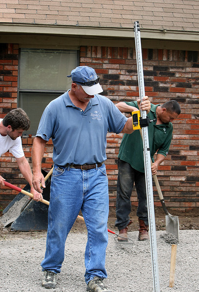 Kevin Randol, Owner of Randol's Ponds and Landscapes, and his team work to install a backyard patio in Broken Arrow.