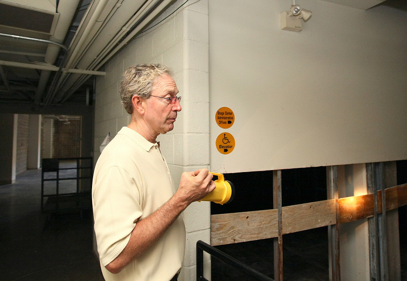 Peter Dolese, executive director at Arts Council of Oklahoma City, points out the rust damage to the supporting steel at the stage Center. In addition to the recent flood damage, cleaning efforts also revealed older damamge from the 1993 flood to the building. PHOTO BY MAIKE SABOLICH