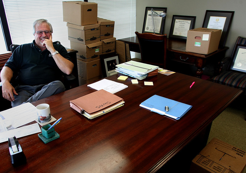 Gerald Hilsher, attorney with McAfee & Taft, moves into his new office in the Mapco Plaza Monday.