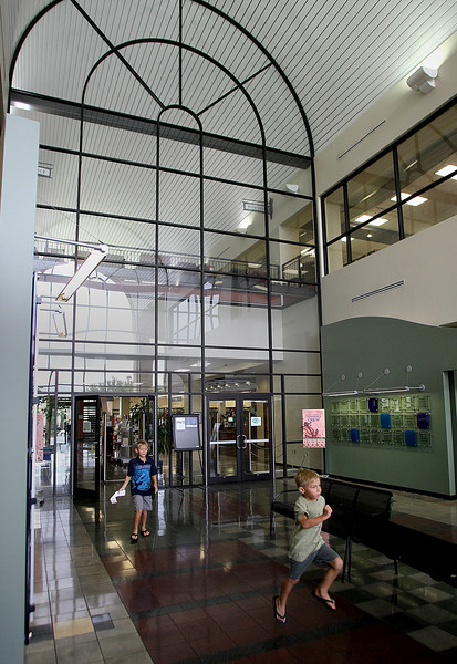 A child runs toward the exit of the Hardesty Regional Library in South Tulsa.