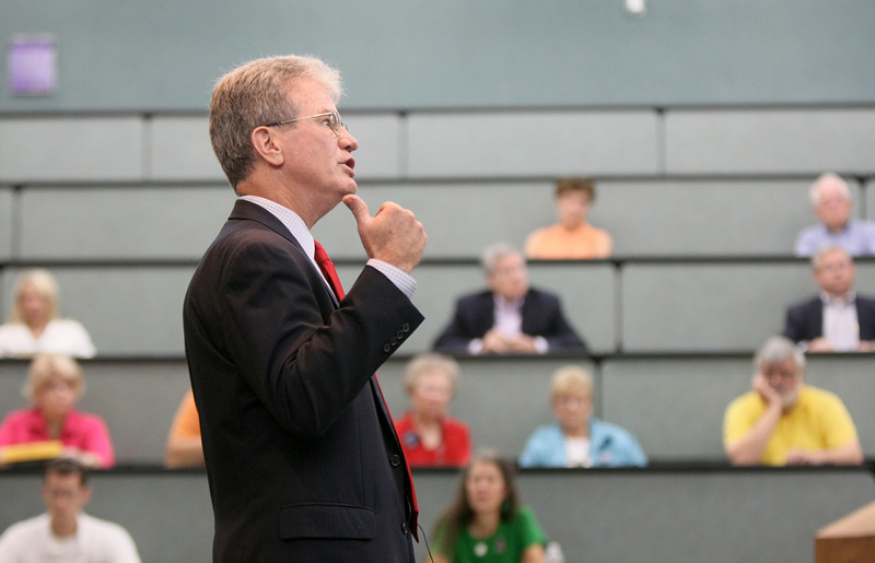 US Sen. Dr. Tom Coburn answers audience questions during a town hall meeting at Francis Tuttle Wednesday. PHOTO BY MAIKE SABOLICH
