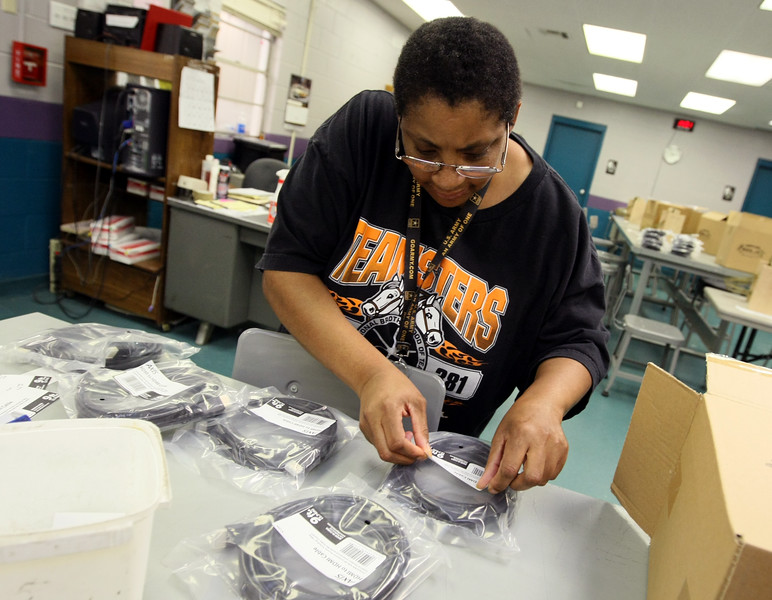 Brenda Elaine Smith puts labels on audio cables at the Dale Rogers Training Center Thursday. PHOTO BY MAIKE SABOLICH