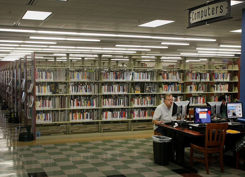 A patron uses one of the many public computers available at the Hardesty Regional Library in South Tulsa.