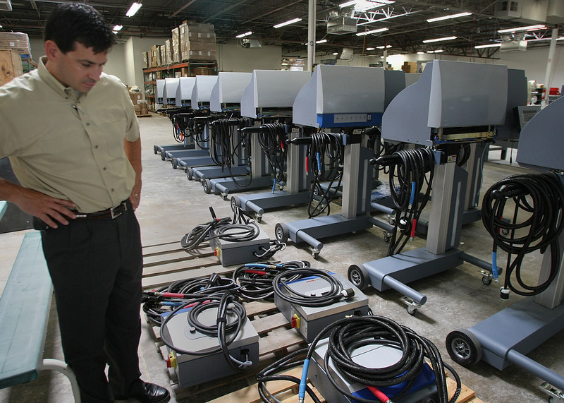 Todd Hanna, General Manager of Pregis, inspects completed foam packing machines built at the companies Tulsa Location.