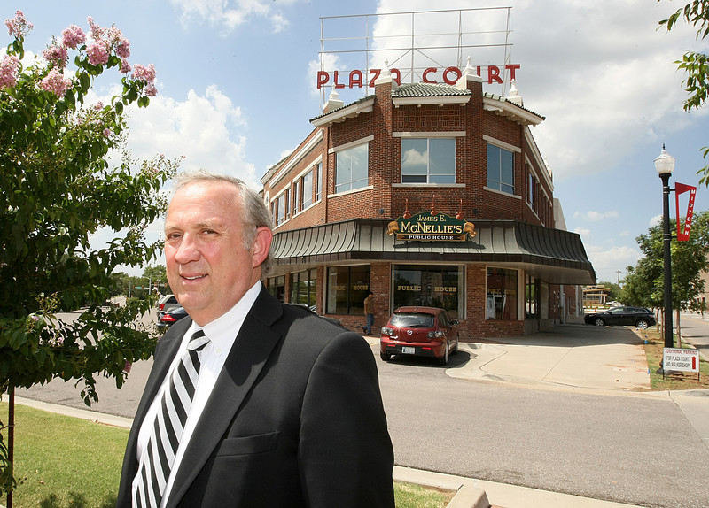 Mickey Clagg, president of Midtown Renaissance, in front of Plaza Court. PHOTO BY MAIKE SABOLICH
