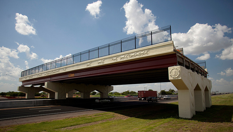 An unfinished overpass on I-35 makes for peculiar site in Norman. Construction equipment on the west side of the interestate shows promise that someday that this will be more than just a bridge to nowhere. PHOTO BY BRENT FUCHS