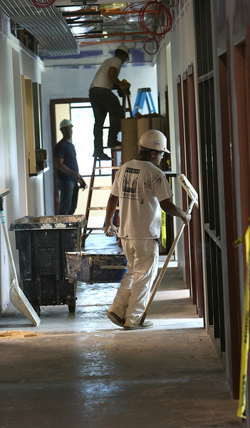 Workmen prepare a 15,000sf extension on the Tulsa Cancer Treatments Center's clinic.  The additional space will double the current clinics size.