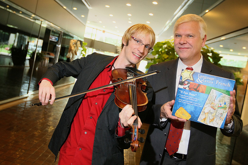 "Kyle Dillingham, Oklahoma's violinist extraordinaire, and Dennis Dunham, executive director of international affairs at the University of Central Oklahoma, recently released ""Il Fait Beau,"" a 10-disc approach to learning the French language through the Broadway musical-style format, a love story woven throughout, the repetition of basic words and a very smart French dog. PHOTO BY MAIKE SABOLICH"