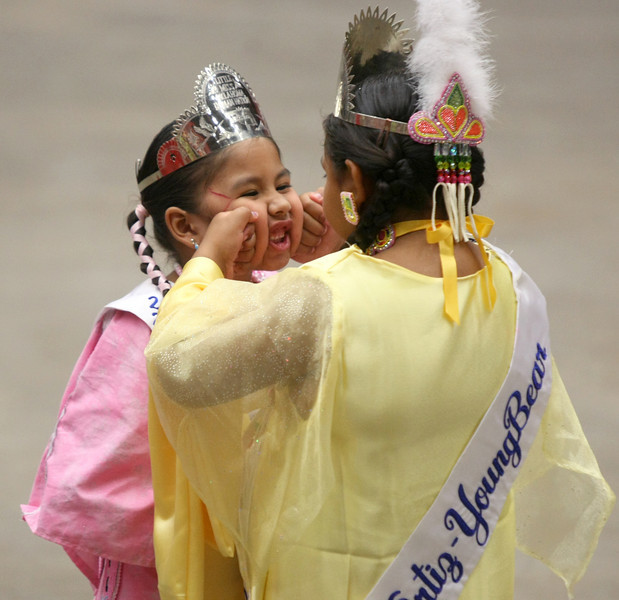 Two young girls fool around during the Red Earth Festival Grand Opening Friday at the Cox Convention Center. PHOTO BY MAIKE SABOLICH