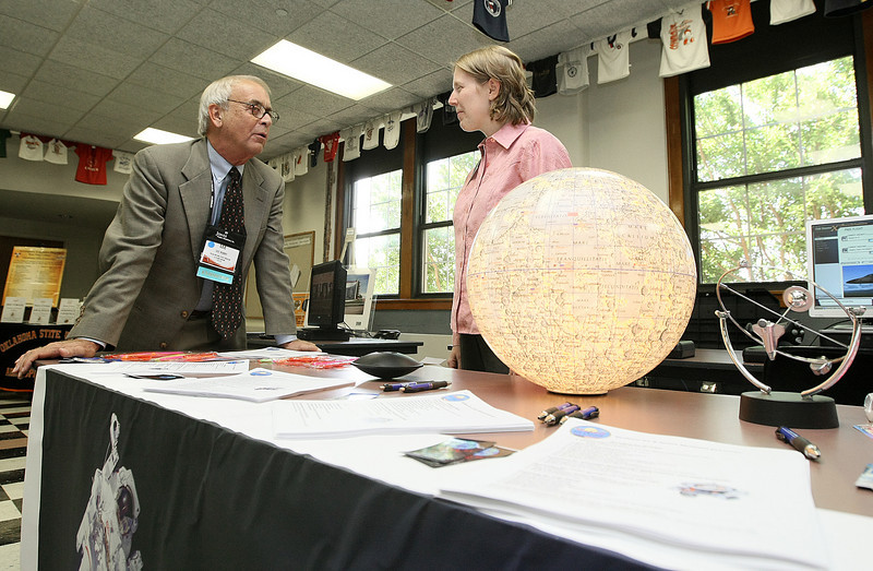 Lee Hubby, board member of the Tulsa Aerospace Museum, and Dr. Tami Martyn with the Stafford Air & Space Museum visit in the exhibit hall during this week's Oklahoma Aerospace Summit and Expo at the Oklahoma School of Science and Mathematics Friday. PHOTO BY MAIKE SABOLICH