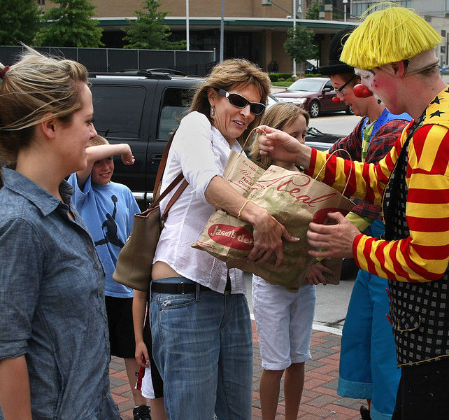 Sarah Mckenna drops off food for the NE Oklahoma Food Bank to Ringling Bros. and Barnum and Bailey circus clowns in downtown Tulsa.  The Circus was providing free tickets to the show for food donations.