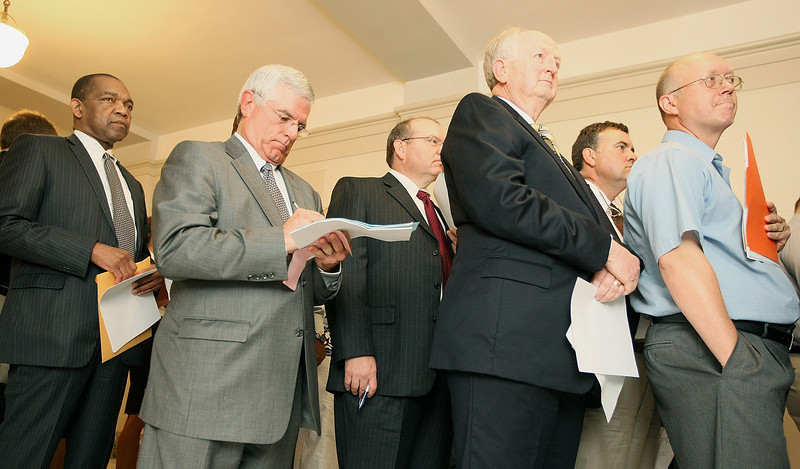 Carlos Chappelle, George Burner Danny Beaver and Dwayne Steidley stand in line to file for their candidacy for different district judge positions Monday at the State Capitol. PHOTO BY MAIKE SABOLICH