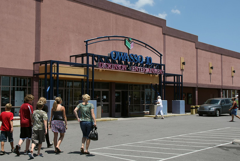 A family heads to the movies at the Dickenson Theatre at 12601 E. 86th St. North in Owasso. ShowPlex Cinemas has paid $4.3M for the Theater.