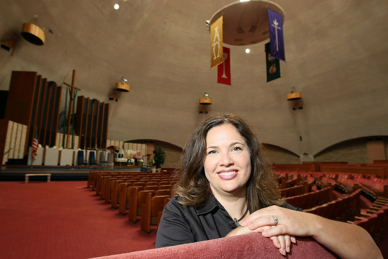 Lynne Rostochil, grandaughter of architect R. Duane Conner, inside the sanctuary of First Christian Church in Oklahoma City. PHOTO BY MAIKE SABOLICH
